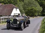 A Vintage Humber Tourer Car passing Burton Mill