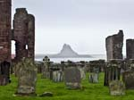 Lindisfarne Castle and Priory from the Churchyard